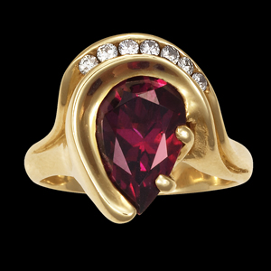 Garnet & diamond swirl ring
